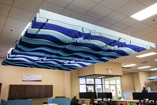 Fi Interiors Level Knoll acoustic ceiling baffle system in reception area of showroom
