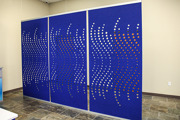 Fi Interiors Define acoustical hanging partitions with cut pattern in acoustic felt